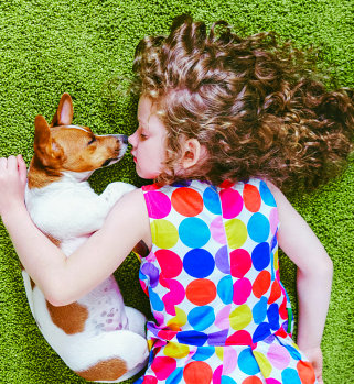 a sleeping dog and child