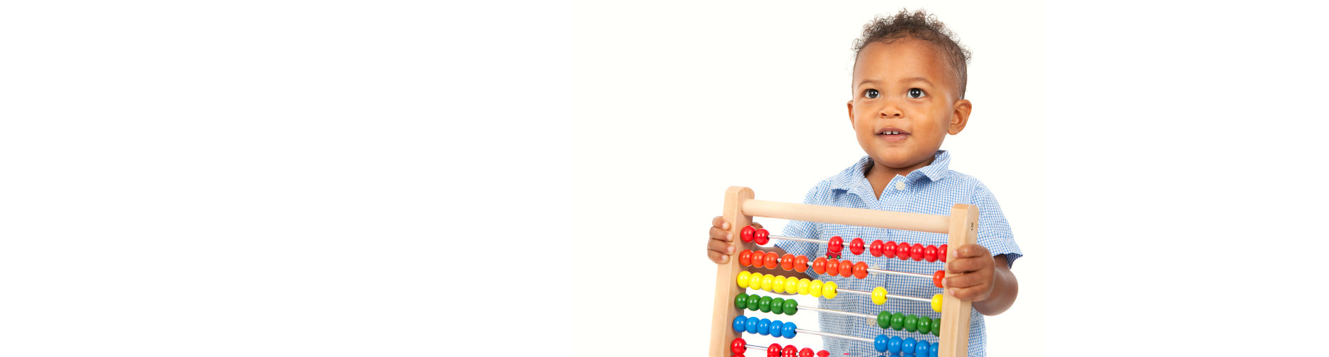a boy holding an abacus